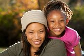 pic of mother daughter  - African American mother and child having fun spending time together in a park - JPG