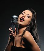 Very Beautiful and gorgeous brunette woman singing