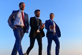 Company Leaders Take A Walk On Sunset Sky Background poster