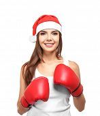 Beautiful young woman in Santa Claus hat and boxing gloves on white background. Boxing Day concept poster