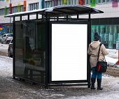 stock photo of bus-shelter  - An image of a bus stop with a blank bilboard for your advertising situated in the swedish city of Helsingborg in the middle of winter - JPG