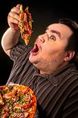 Diet failure of fat man eating fast food slice pizza on plate. Close up of breakfast for hungry over poster