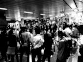 Blurred Image Of Asian People On The Queue Line On Rush Hour Waiting For Train Subway Station. Stay poster
