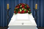 stock photo of mortuary  - A white coffin with flowers in a mortuary - JPG