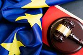Judges Wooden Gavel With Eu Flag In The Background. Symbol For Jurisdiction. Wooden Gavel On Europea poster