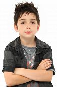 foto of brown-haired  - Attractive eight year old portrait of boy with stylish hair over white arms crossed - JPG