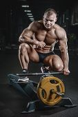 Brutal Caucasian Bodybuilder Working Out In Gym poster