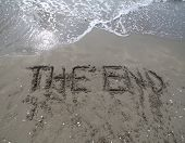Text The End Written On The Sand And The Wave That Is Deleting T poster