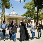 Group Of Young Muslim Girls In Topkapi Countryard  In Istanbul