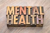 mental health -word abstract in vintage wood letterpress printing blocks poster