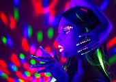 Neon Woman dancing. Fashion model woman in neon light, portrait of beautiful model with fluorescent  poster