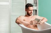 Relax Concept. Man Muscular Torso Relax Bathtub And Read Book. Relaxed Guy Reading Book While Relaxi poster