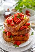 French Toasts, French Toasts Made Of Sliced Brioche With Fresh Strawberries, Honey And Mint. Delicio poster