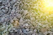 Road Gravel And Granite Gravel Texture. Crushed Gravel Background. Pile Of Stones Texture With Sunbe poster