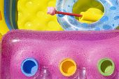 foto of spank  - Composition made of airbed swimming pool and float with fresh colors and waterdrops - JPG