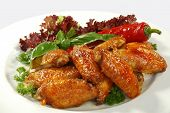 foto of fried chicken  - fried chicken wings in friture with red pepper - JPG