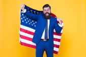 Honour And Glory To My Country. Happy Businessman Holding Old Glory American Flag On Yellow Backgrou poster