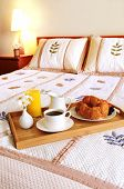 stock photo of bed breakfast  - Tray with breakfast on a hotel room bed - JPG