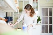 stock photo of cleaning house  - Young woman doing housework - JPG