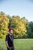 Alternative White Male Man With Pink Hair Gazing In The Distance, Contemplative. poster