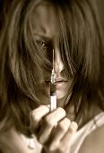 foto of intravenous  - Young woman with drug addiction on dark background