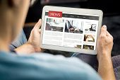 Online News Article On Tablet Screen. Electronic Newspaper Or Magazine. Latest Daily Press And Media poster