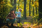 Family Time. Brutal Bearded Man And Little Boy Enjoy Autumn Nature. Family Leisure. Family Values. E poster