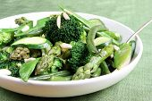 image of mange-toute  - Serving bowl of mixed green vegetables topped with toasted almond - JPG