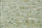 foto of trapezoid  - pattern color of modern style design decorative green slate stone wall surface with cement in trapezoid shape - JPG