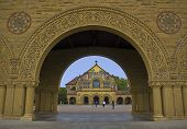 stock photo of quadrangles  - This is a picture of the Stanford Memorial Chapel through an arch of the Quad the university quadrangle - JPG