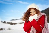 stock photo of grils  - Beautiful gril with the curly hair in the snow country - JPG