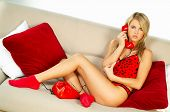picture of people talking phone  - sexy blonde girl with red phone close up - JPG