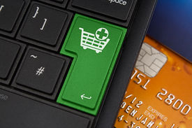 image of qwerty  - Add to Cart Enter Key on a modern laptop qwerty keyboard with bank smart card underneath to represent online shopping - JPG