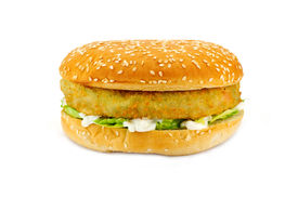 stock photo of veggie burger  - Breadcrumbed vegetarian or veggie burger could also be used for chicken burger or fish burger - JPG