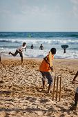 Bentota, Sri Lanka - Apr 28: Teenagers Play Cricket With Bat And Ball On Sandy Beach On Apr 28, 2013