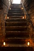 stock photo of dungeon  - Spooky dungeon stone stairs in old castle - JPG