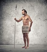 stock photo of caveman  - caveman with spear and fur - JPG