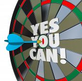 The importance of confidence and a positive attitude illustrated by a dart hitting the words Yes You