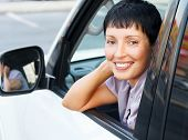 Smiling senior woman in a car