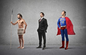 stock photo of primite  - evolution of man from caveman to super hero - JPG