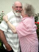 foto of male pattern baldness  - Grandmother kissing her husband - JPG