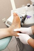 pic of chiropodist  - Professional massage at a chiropodist in his practice - JPG