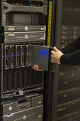 stock photo of chassis  - Install or remove a server in a blade chassis in a rack - JPG