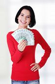 Cheerful young lady holding cash - polish zloty ( pln )