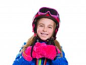 Blond kid girl happy going to snow with ski poles helmet and goggles