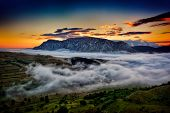 foto of humidity  - beautiful mountain landscape in foggy morning in Alba - JPG