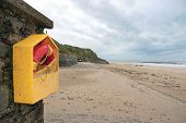 stock photo of safe haven  - a rescue buoy at ballybunion beach in ireland on a cold snowy deserted winters day - JPG