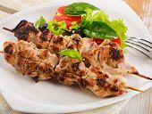 picture of kababs  - Grilled chicken kebab served with fresh salad - JPG