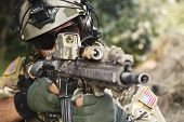 pic of trooper  - american soldier pointing hi rifle during the military operation - JPG