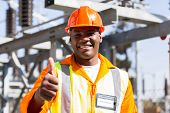 image of substation  - portrait of african electrician with thumb up at substation - JPG